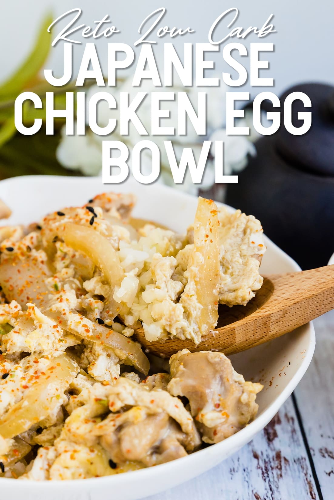 Japanese chicken and egg bowl with a spoon