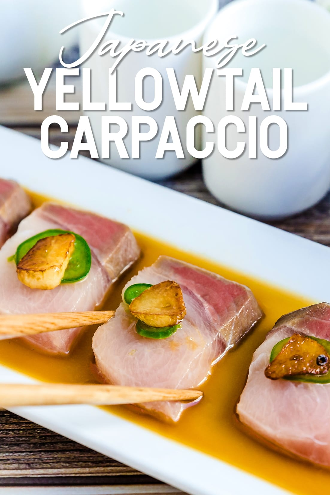 Yellowtail Carpaccio in Yuzu Sauce with chopsticks