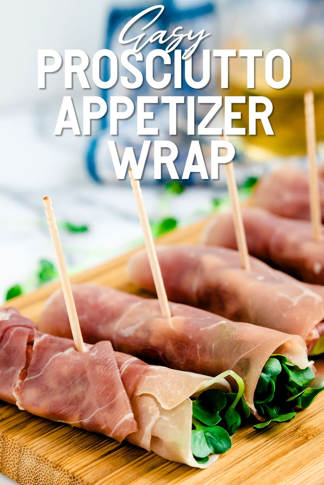 Prosciutto Appetizer Wrap lined up on a serving plank