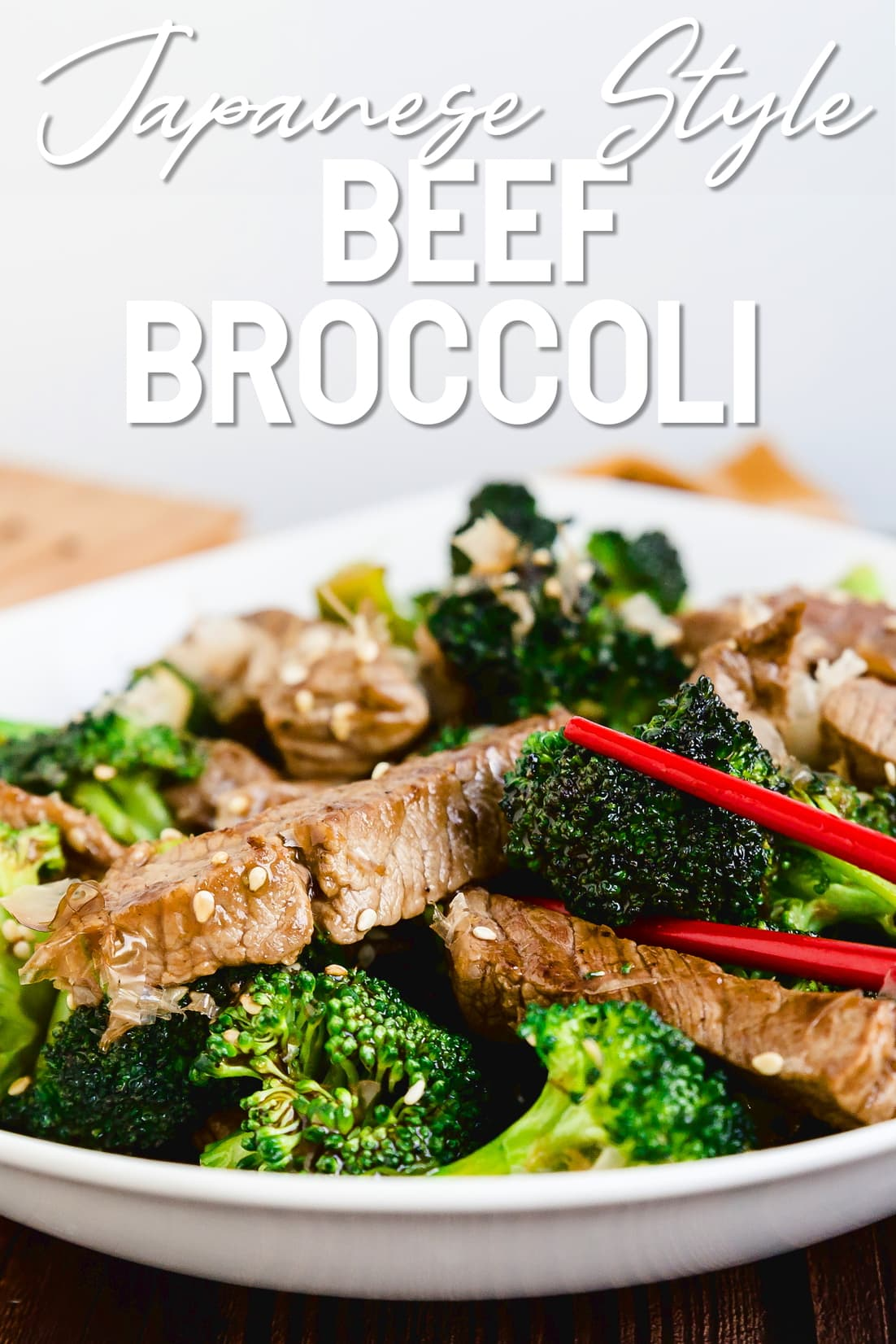 Keto beef and broccoli being picked up with chopsticks