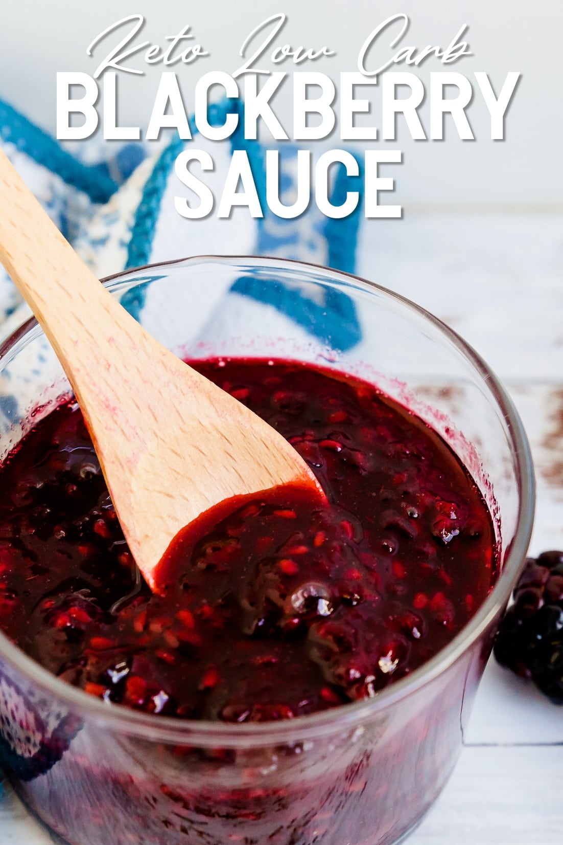Keto Blackberry Sauce in a jar with a spoon