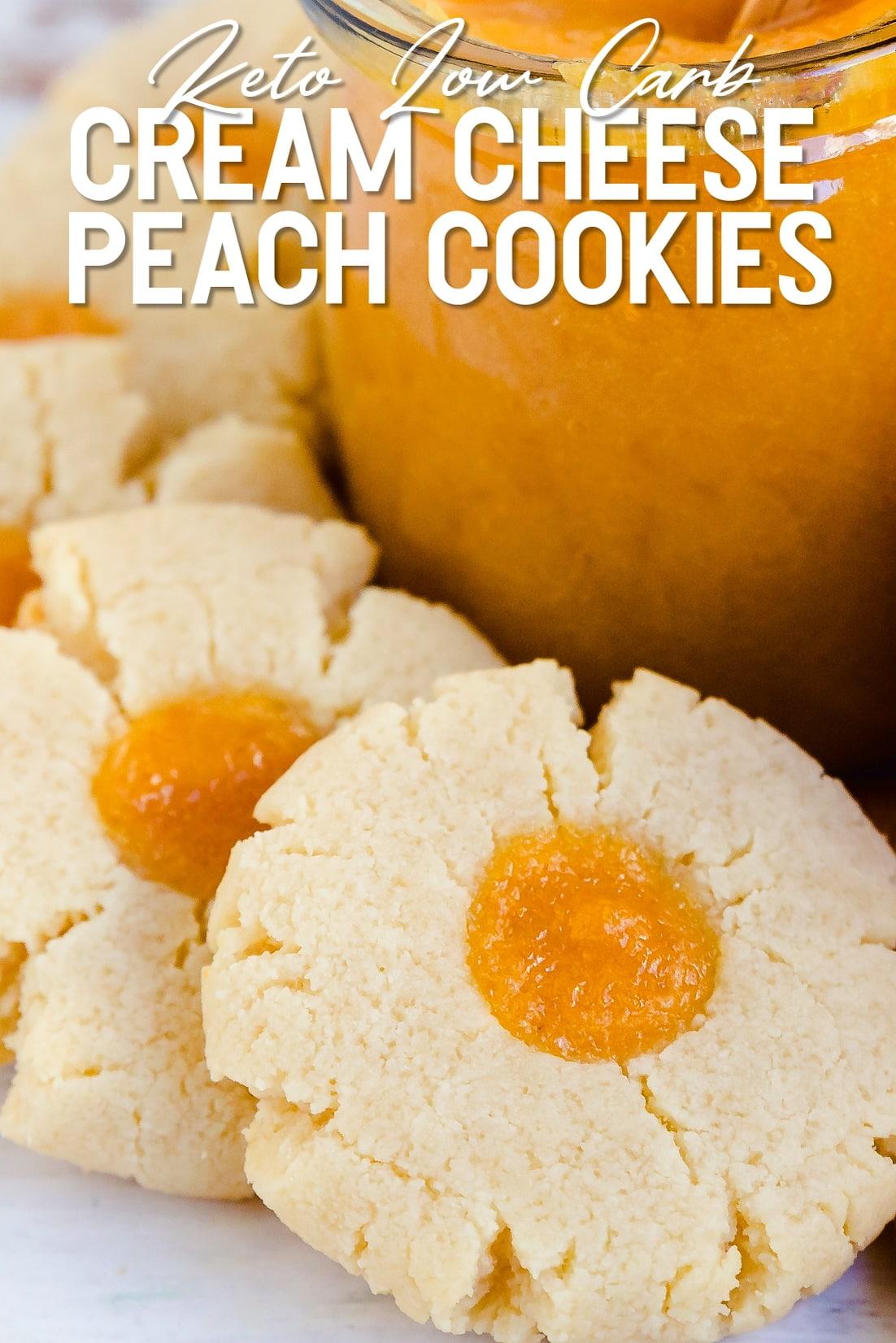 Keto Cream Cheese Peach Cookies Laying down next to jar of peach sauce