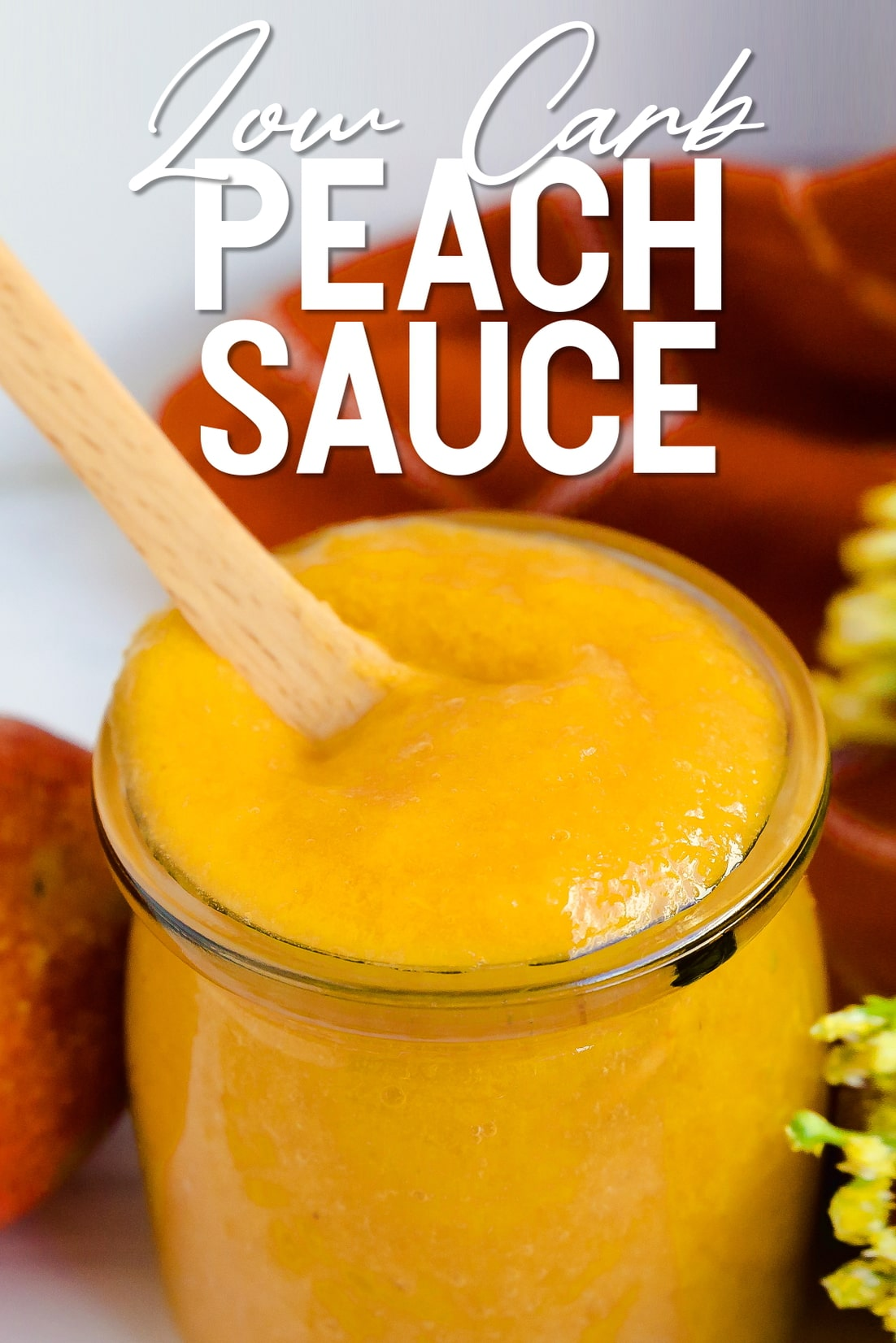 Low Carb Peach Sauce with a spoon inside
