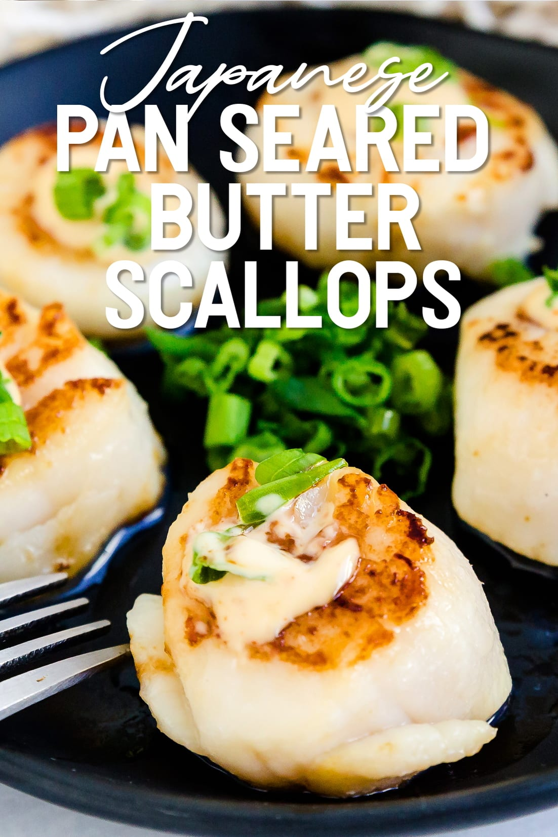 Japanese Style Butter Pan Seared Scallops served on a black plate with a fork