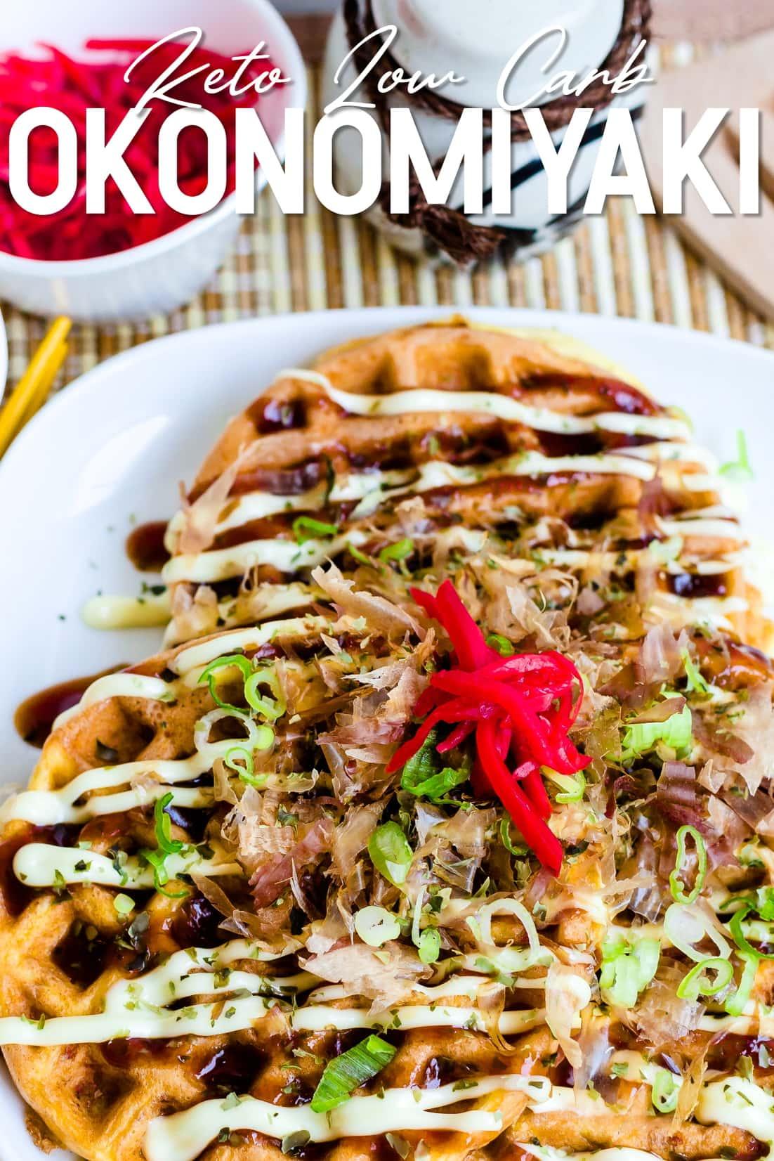 Keto Chaffle Okonomiyaki on a serving plate with beni shoga, sauce, and mayo