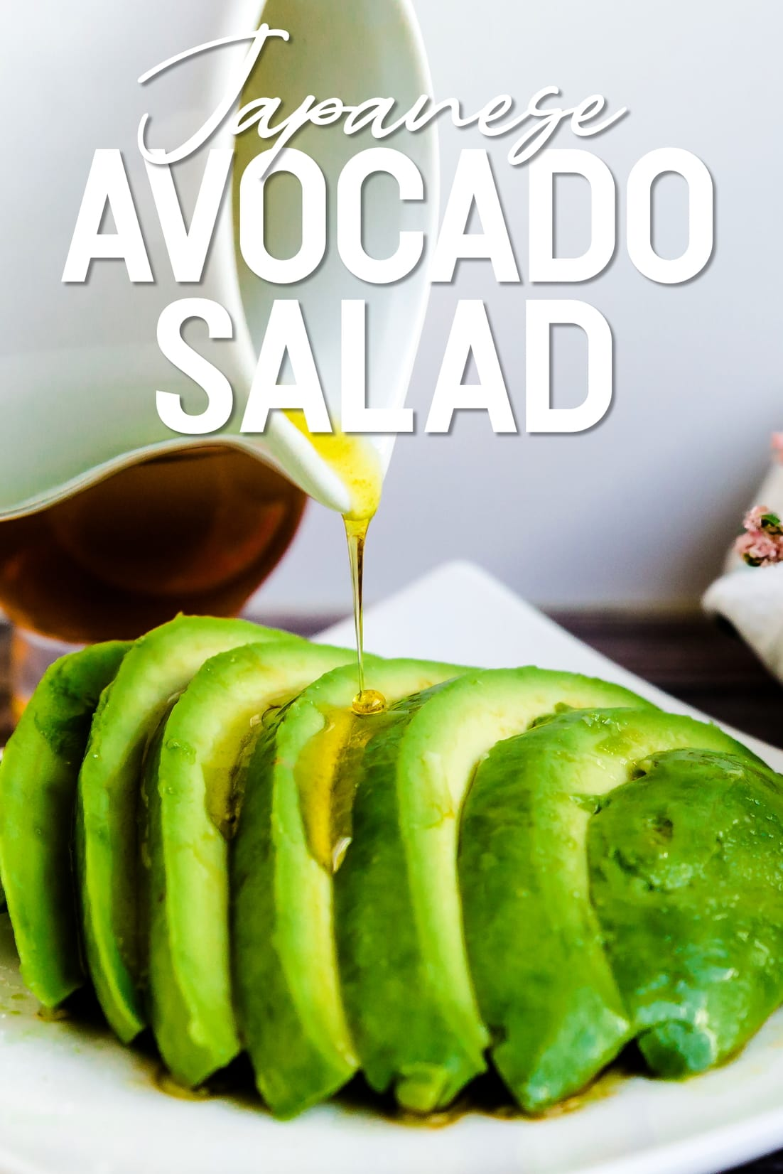 Japanese Avocado Salad with dressing being poured on