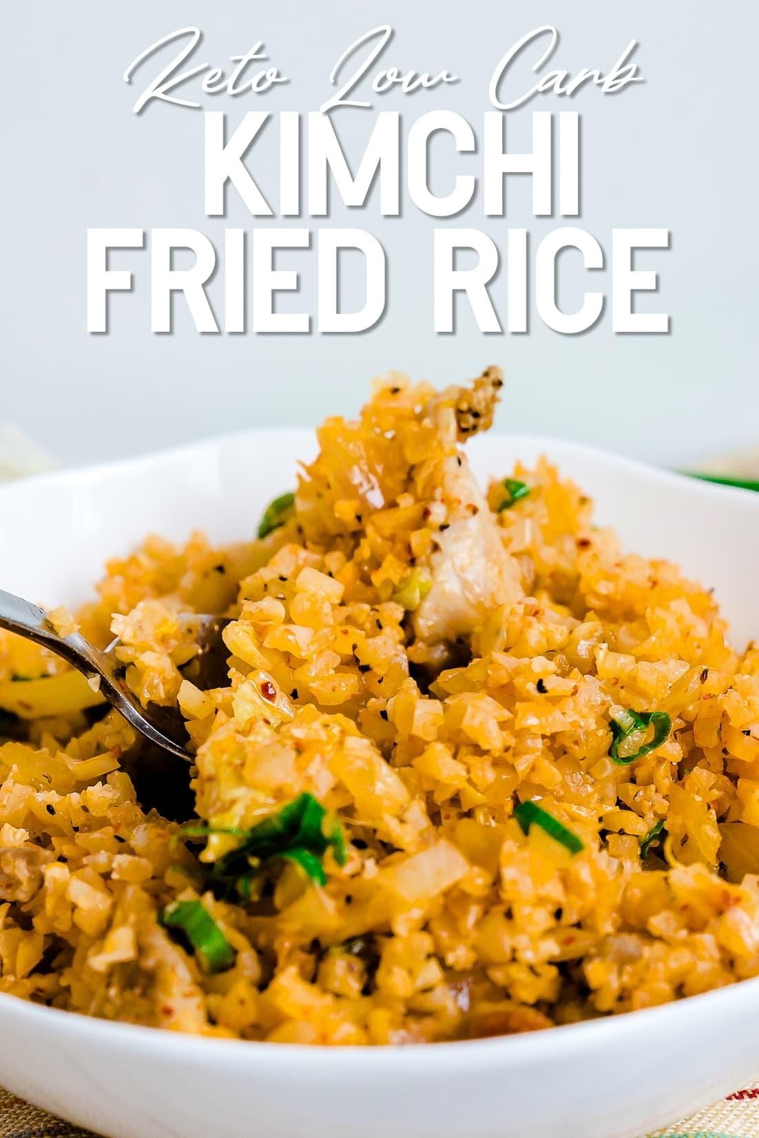 Keto Chicken Kimchi Cauliflower Fried Rice being spooned
