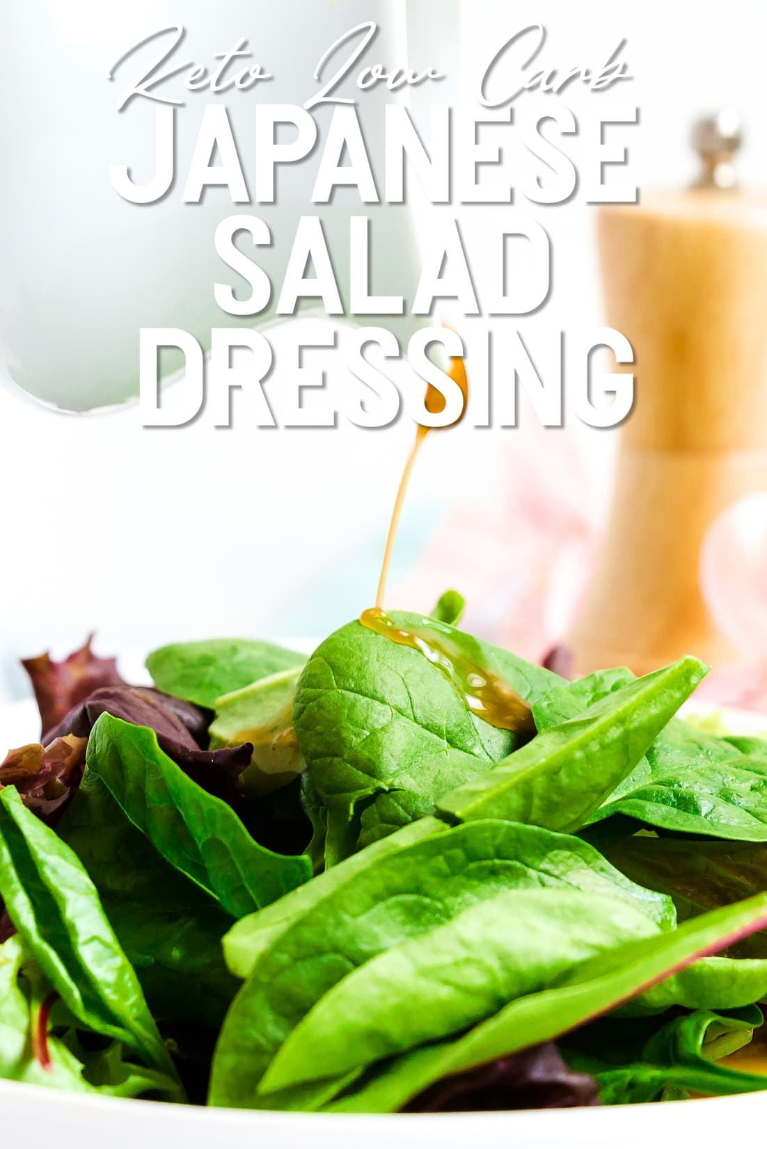 Keto Japanese Salad Dressing being poured onto a sping mixed salad