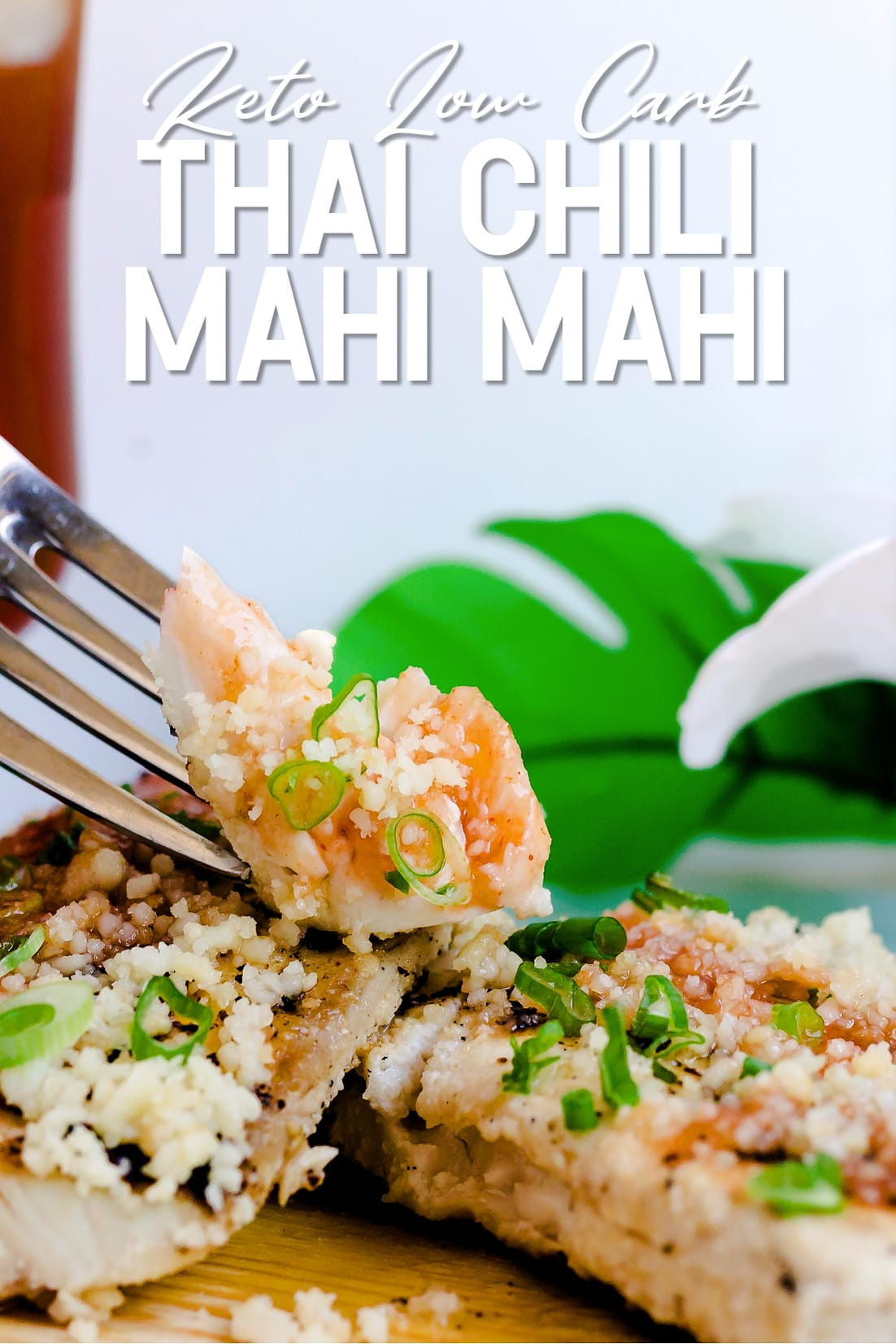A piece of Thai Chili Mahi Mahi being held up by fork