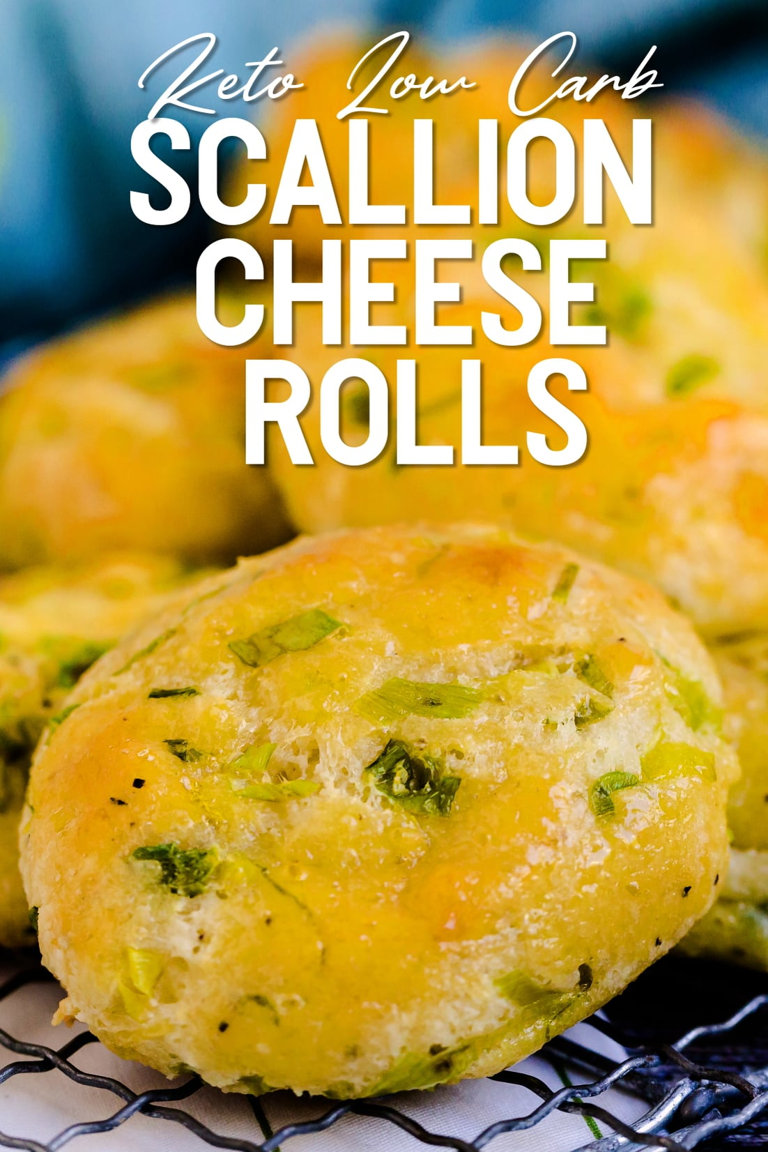 Keto scallion green onion cheese rolls stacked on a cooling rack