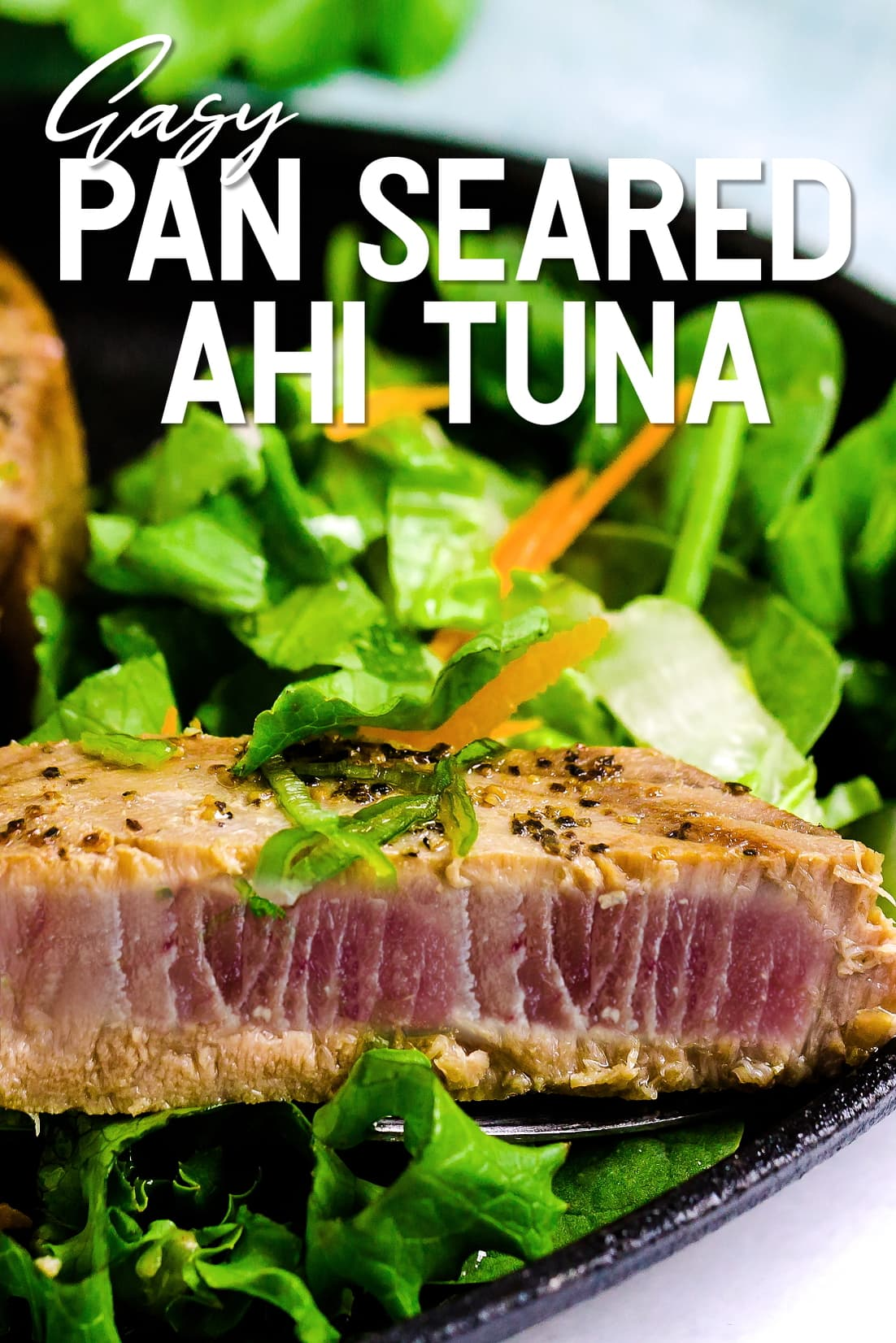 Pan Seared Ahi Tuna cut in half served on a bed of lettuce