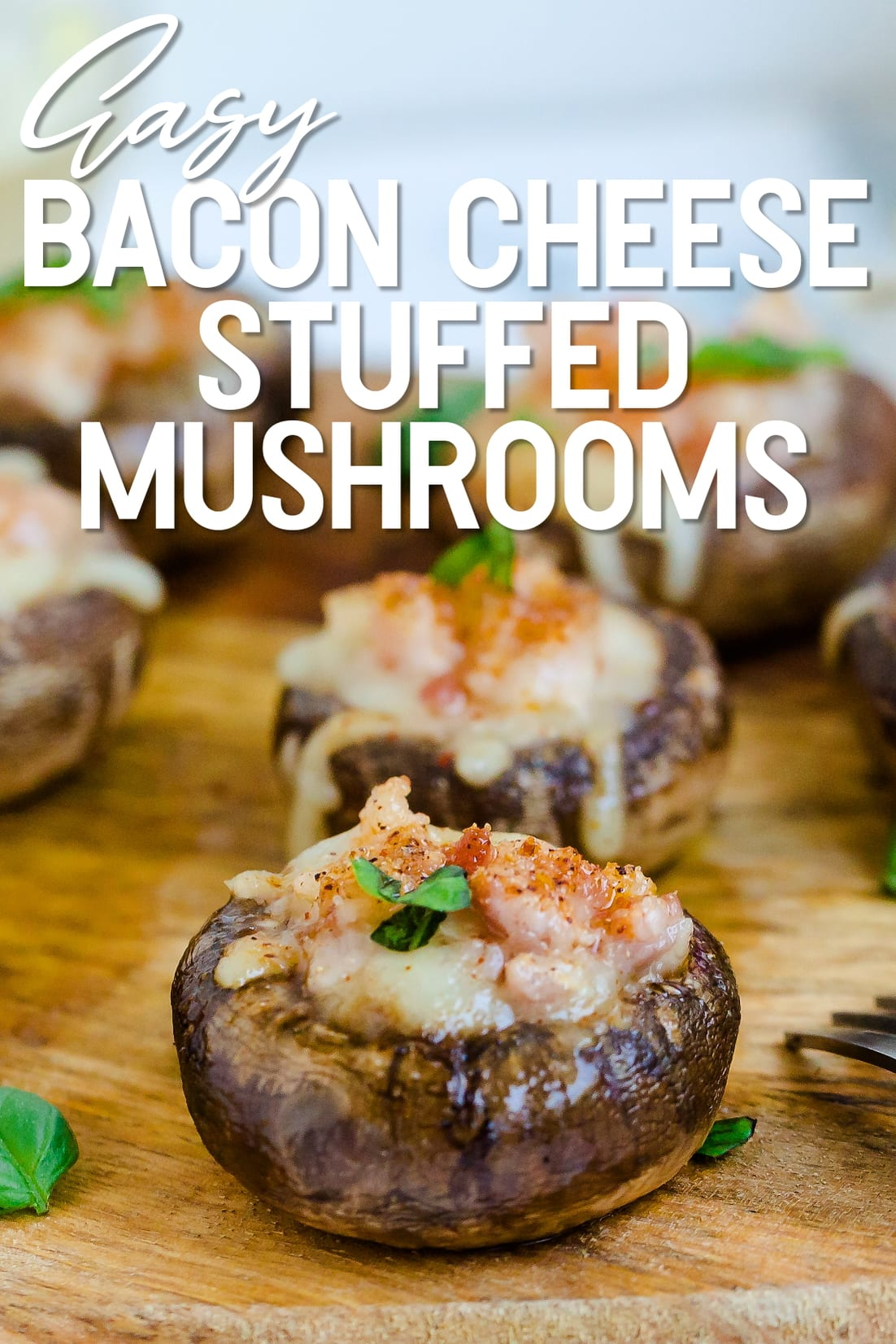 Bacon Cheese Stuffed Mushrooms served on a wooden plank