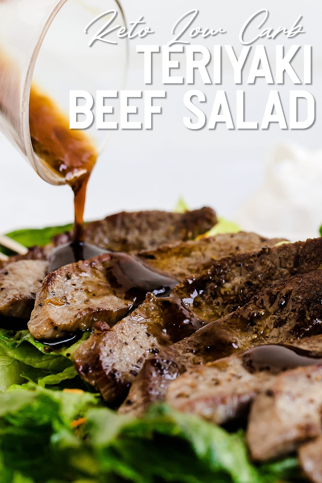 Teriyaki Beef Salad with sauce being poured