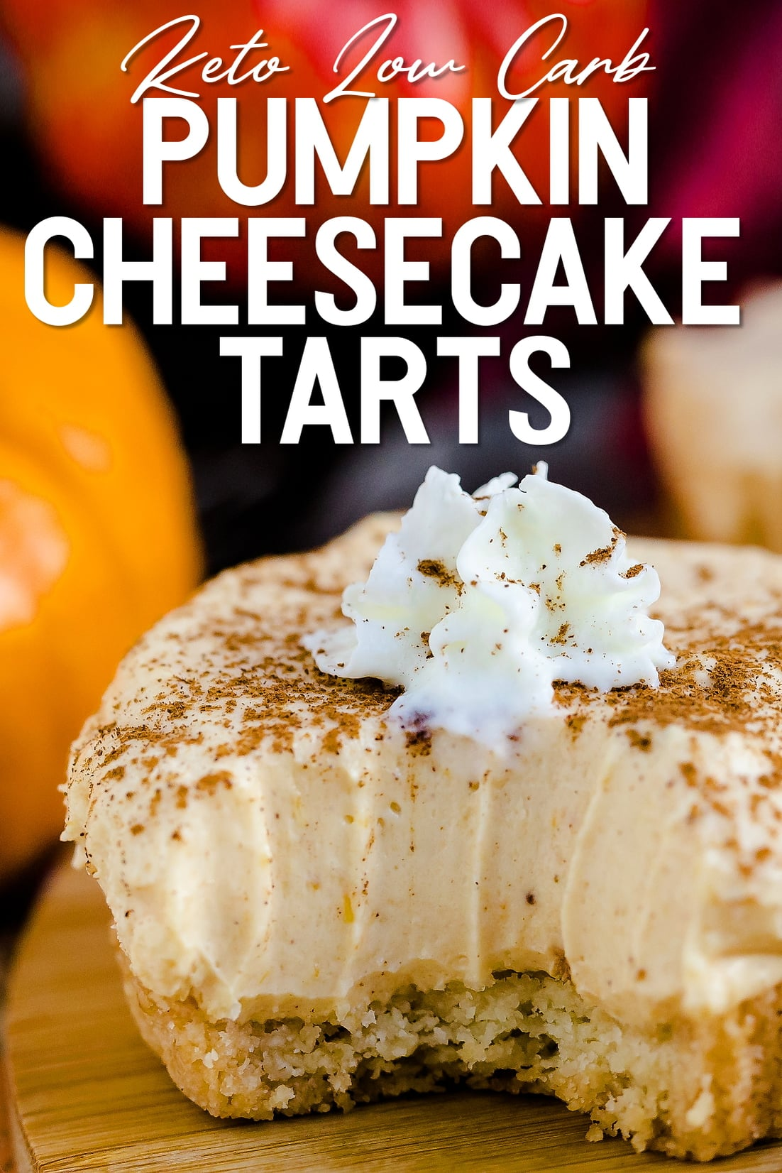 Keto Low Carb Pumpkin Cheesecake Tart being biten into