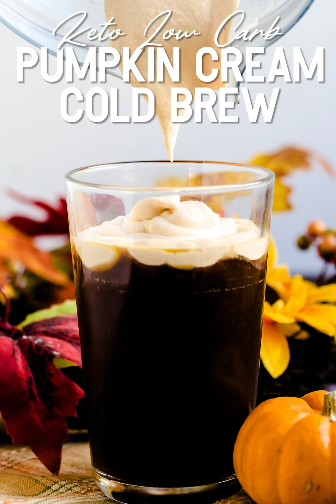 Keto Pumpkin Cream being poured on top of iced coffee