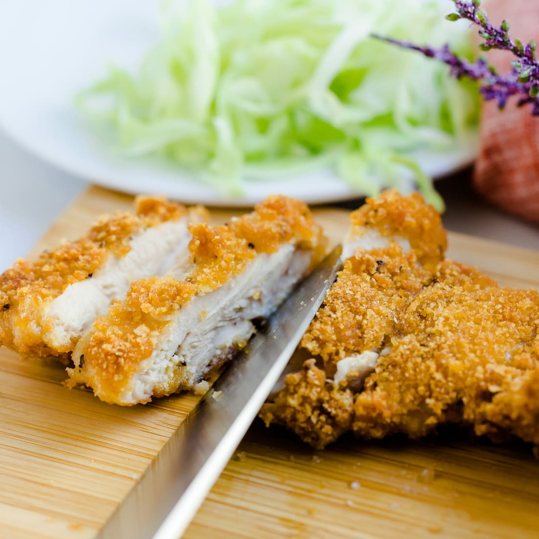 Air Fried Japanese Chicken Cutlet being cut into slices