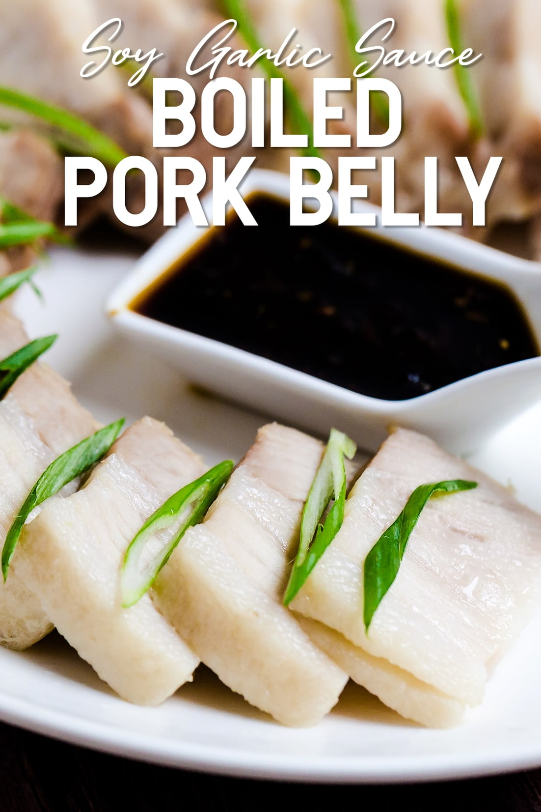 Boiled Pork Belly with Soy Garlic Sauce served on a white plate