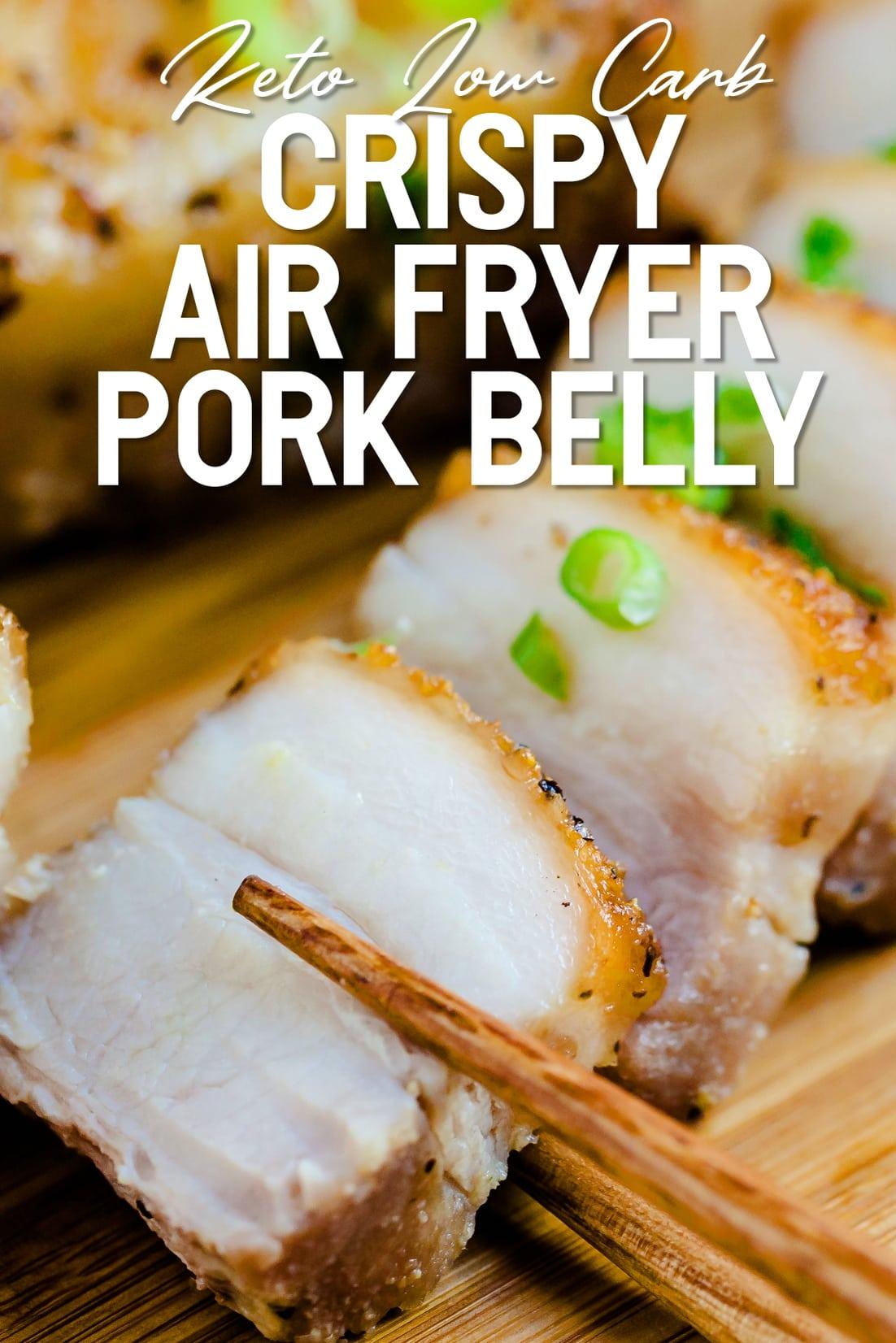 Crispy Pork Belly being held up by chopsticks