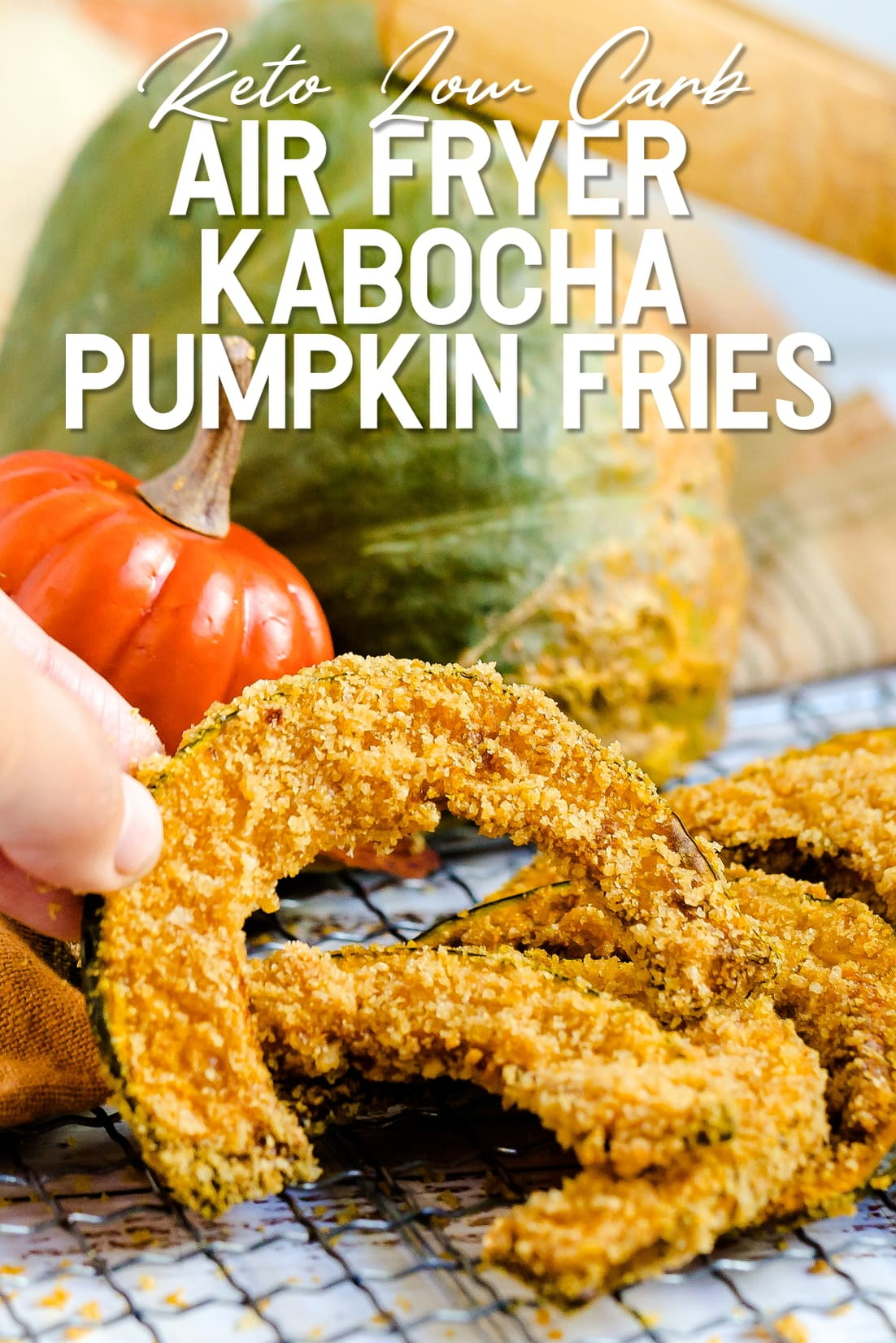 Keto Air Fried Kabocha Pumpkin Fries being picked up with fingers