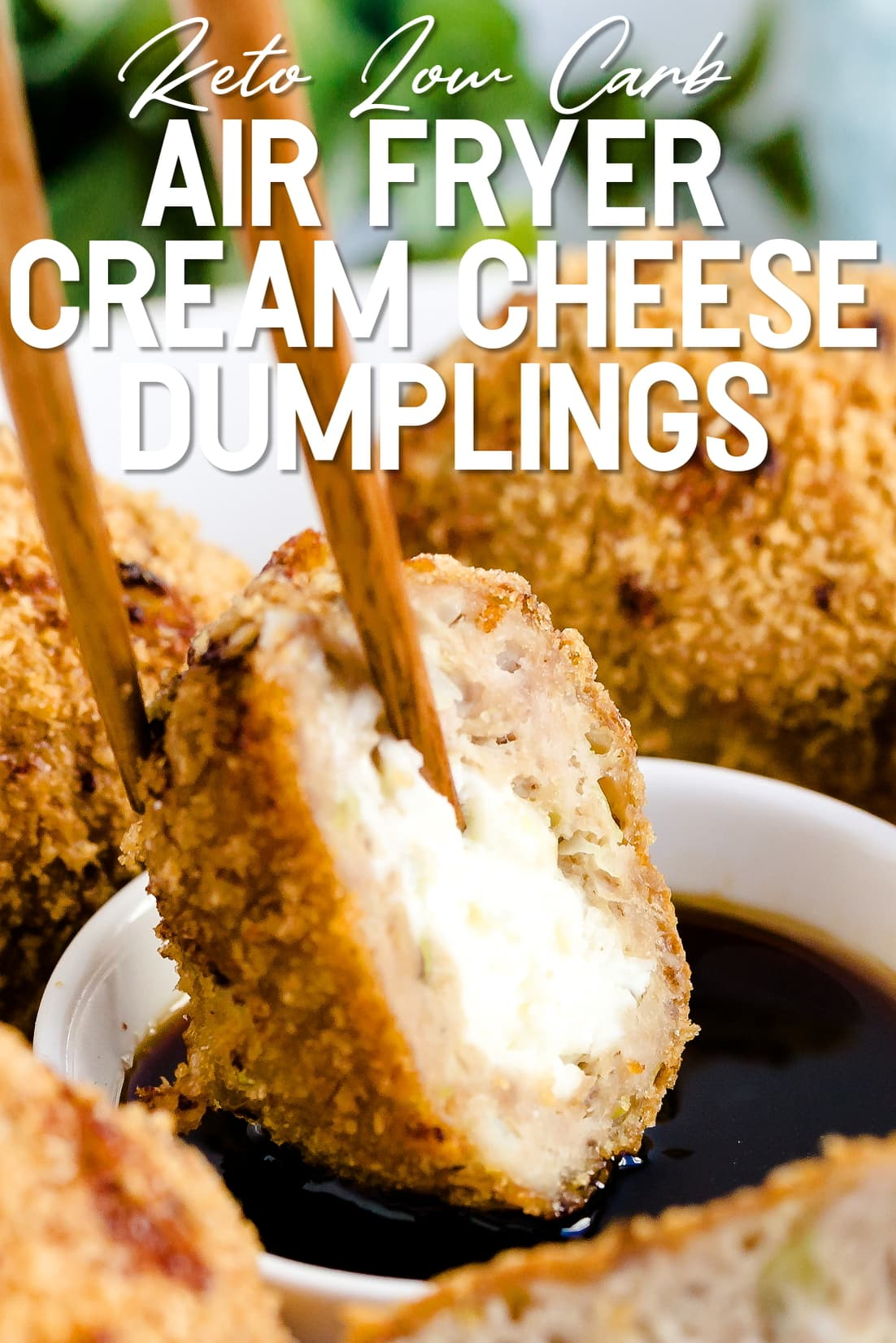 Cream Cheese Dumpling being dipped in sauce