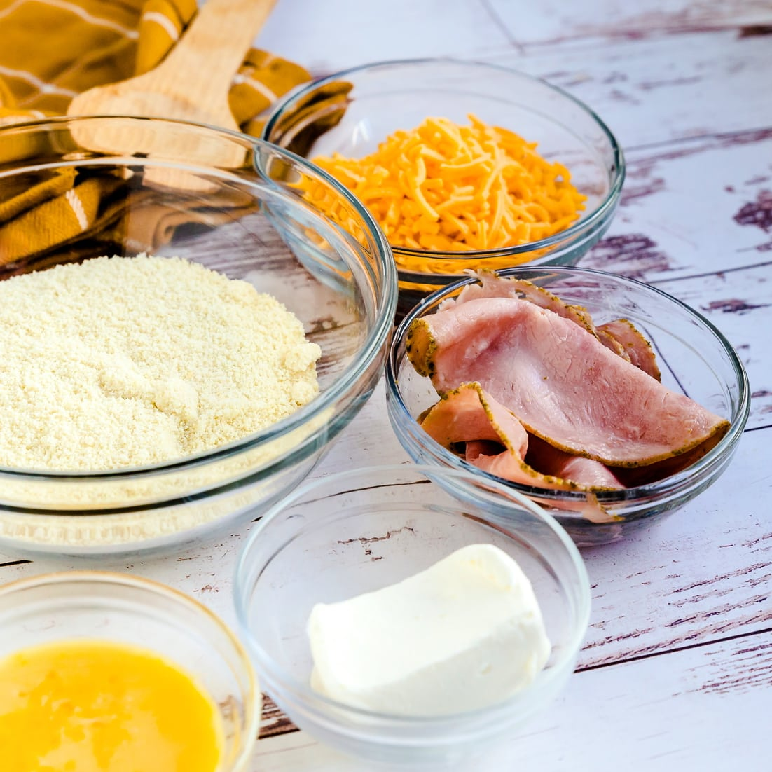 Ingredient for Ham and Cheddar Bread Rolls prepared in glass mixing bowl