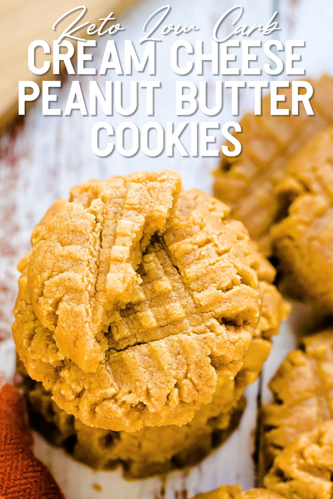 Keto Cream Cheese Peanut Butter Cookies stacked on top of each other