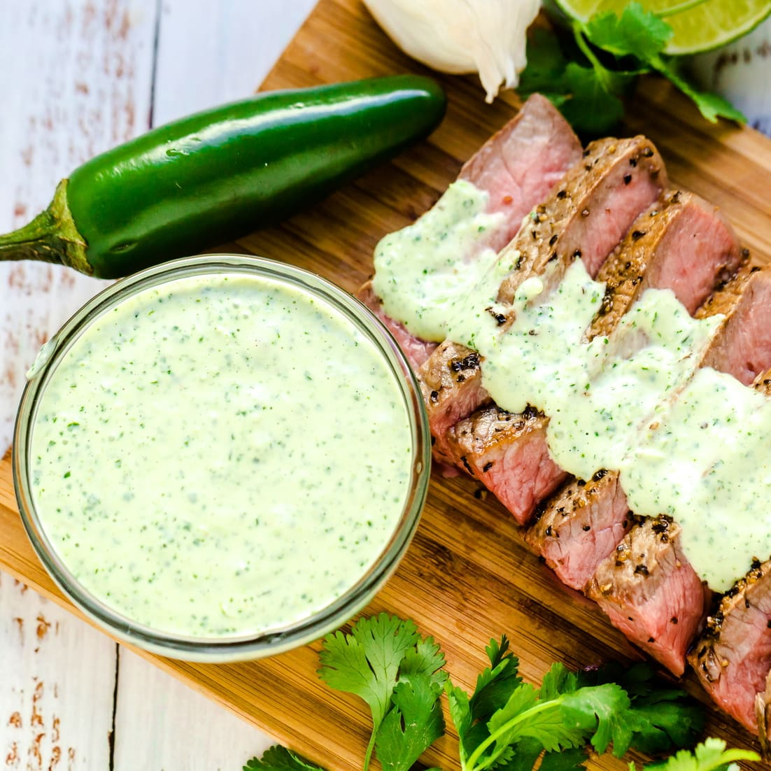 The green sauce drizzled over New York steak