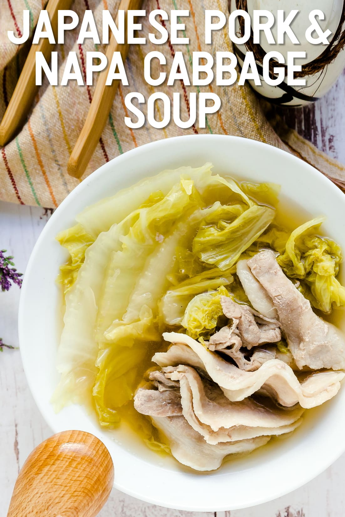 Japanese Pork and Napa Cabbage Soup served in a white bowl with wooden spoon