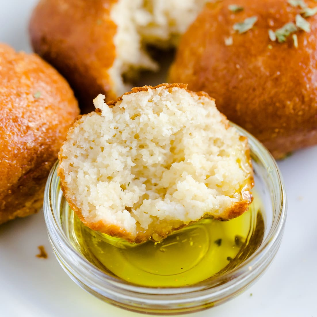 Keto Air Fryer Cheese Biscuits dipped in olive oil