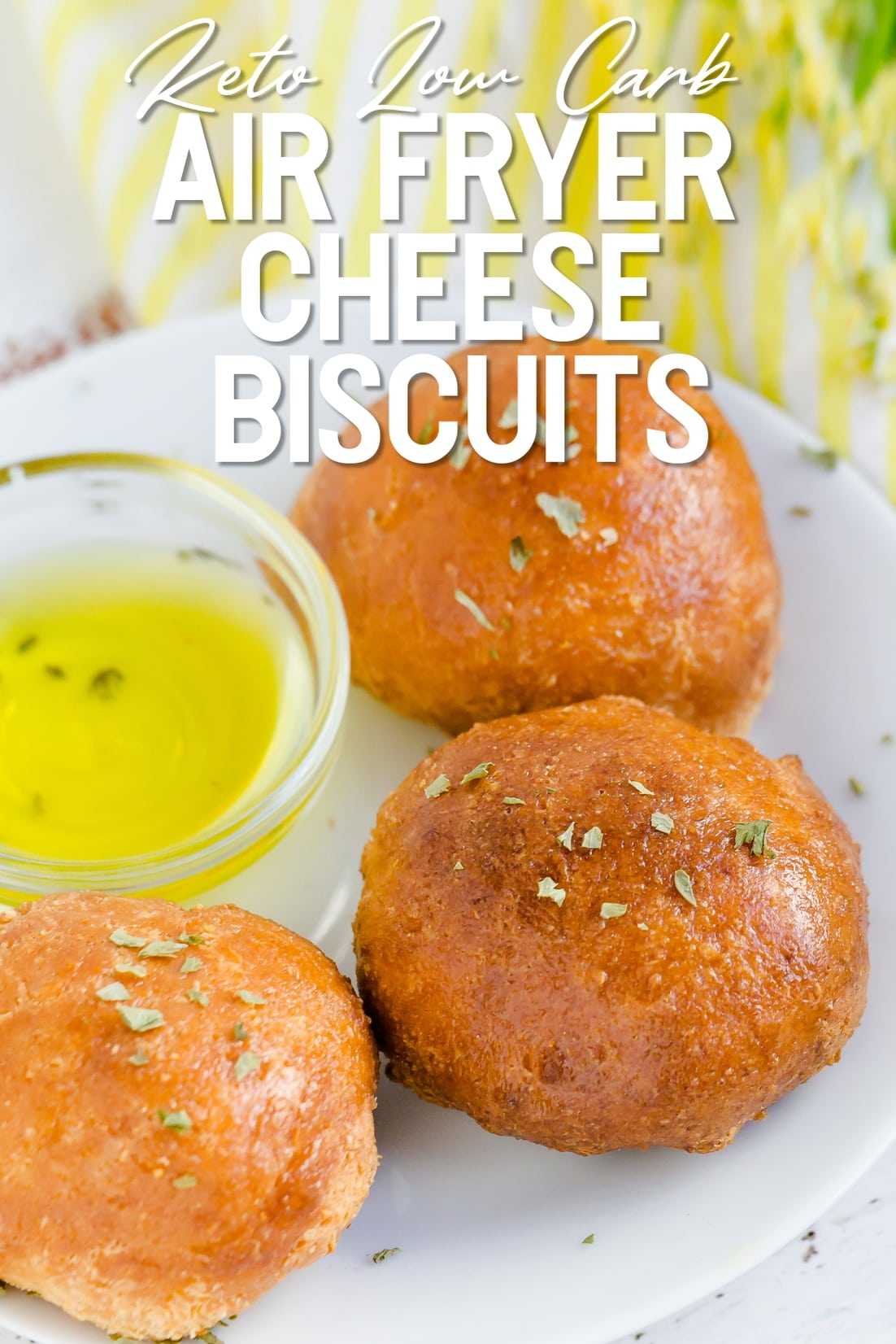 Keto Air Fryer Cheese Biscuits on white plate with olive oil
