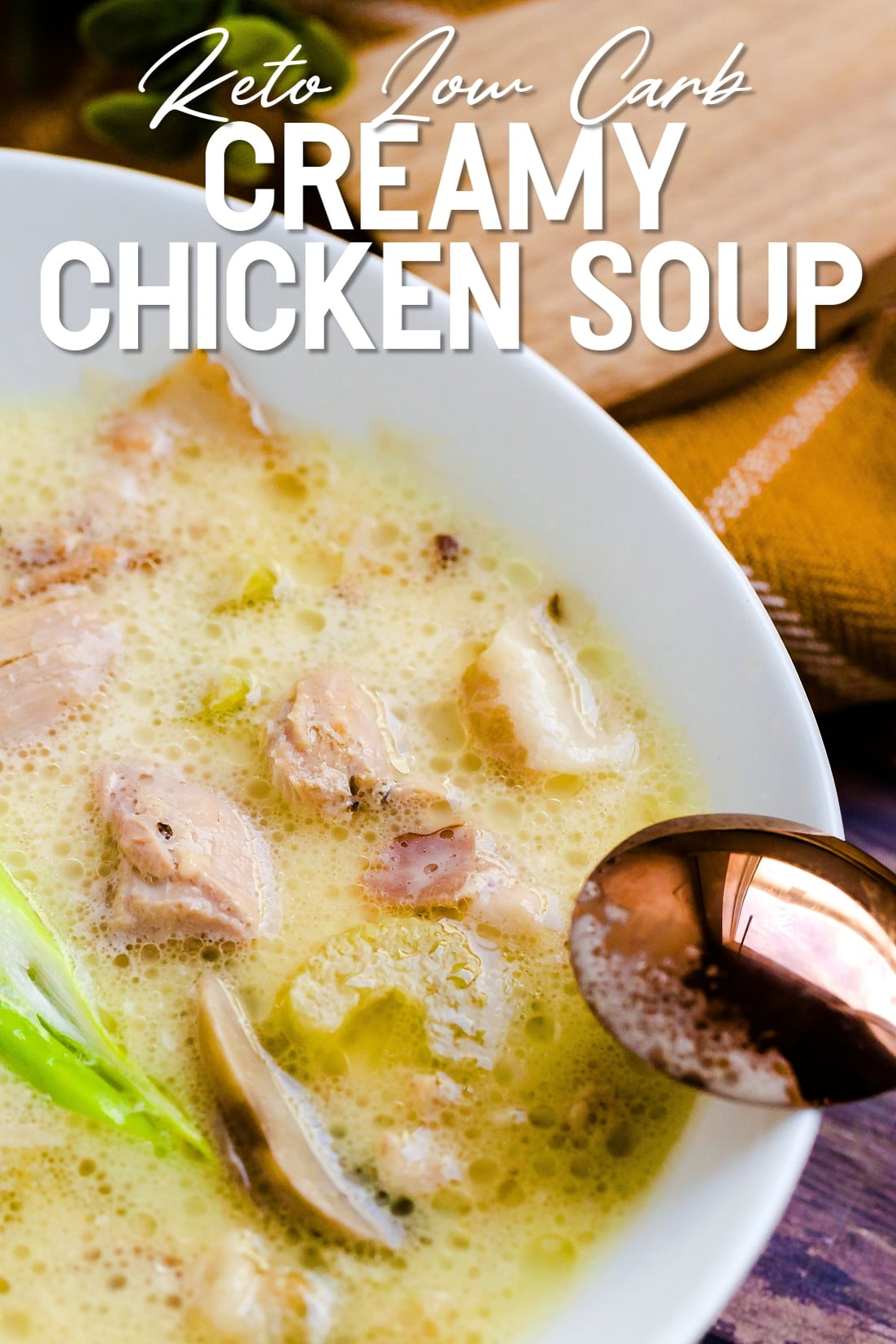 Keto Creamy Chicken Soup served in a white bowl with a golden spoon