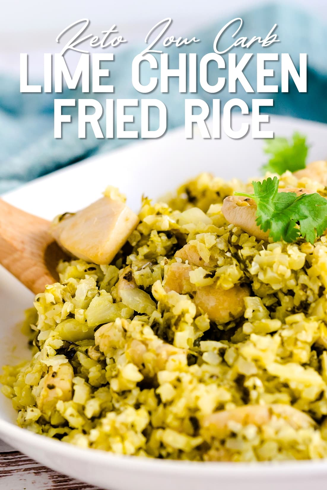 Keto Lime Chicken Cauliflower Fried Rice with wooden spoon