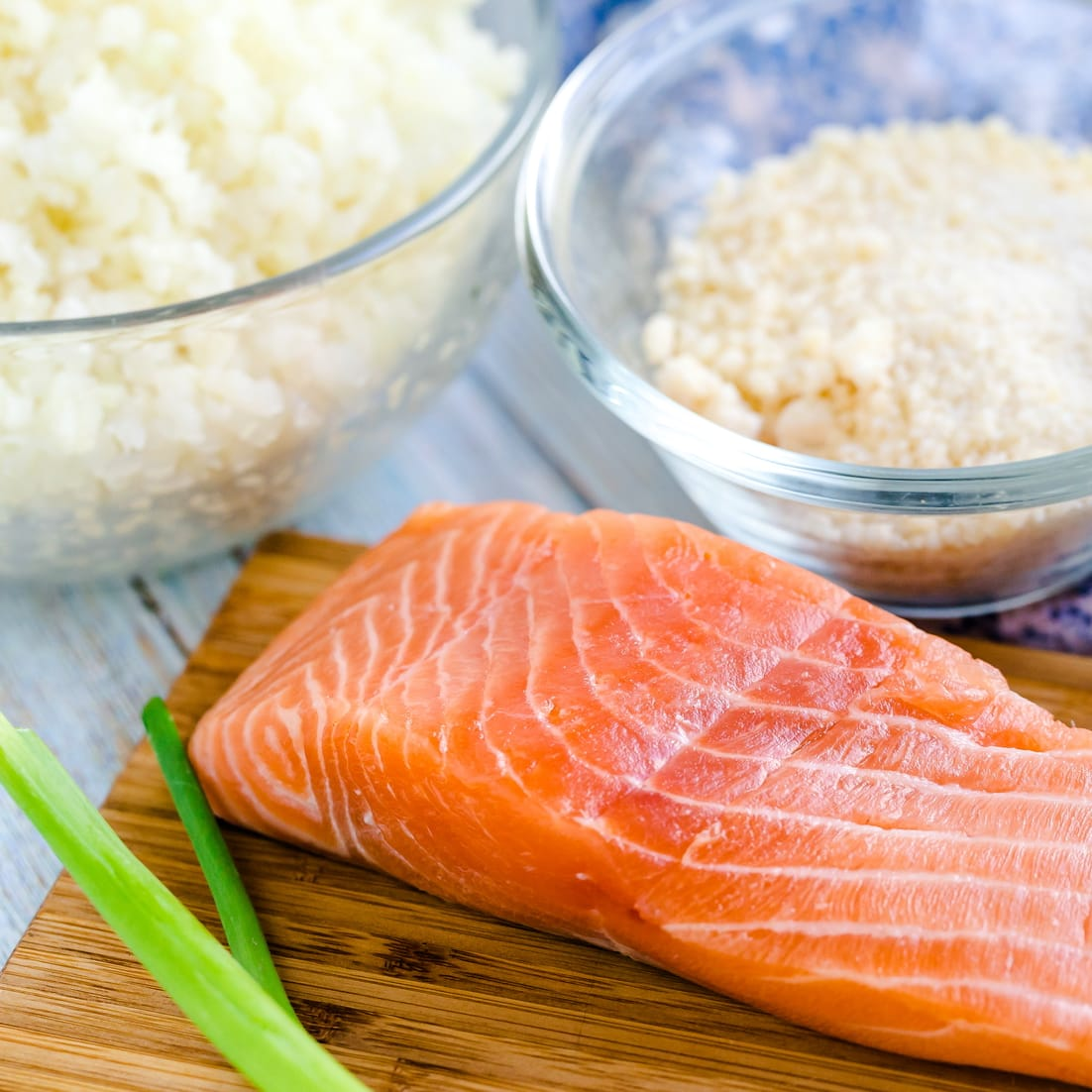 Ingredients for Keto Salmon Cauliflower Risotto on wooden chop board
