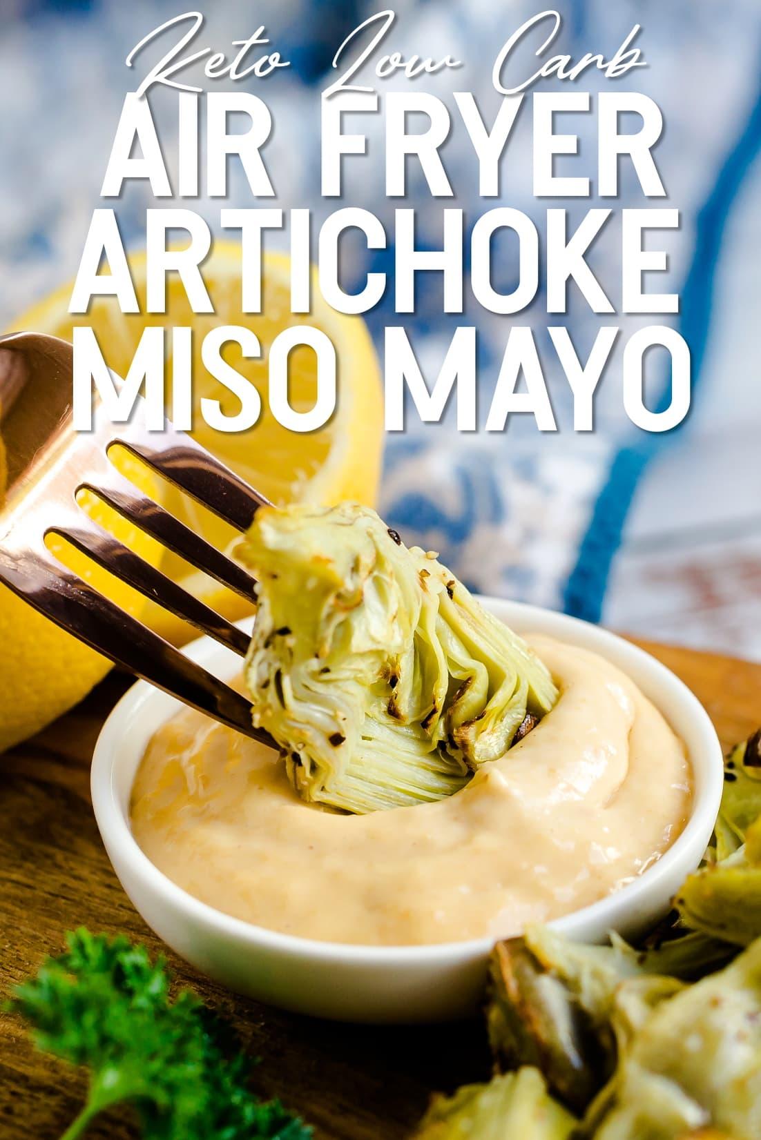 Air Fryer Artichoke being dipped in garlic miso mayo sauce