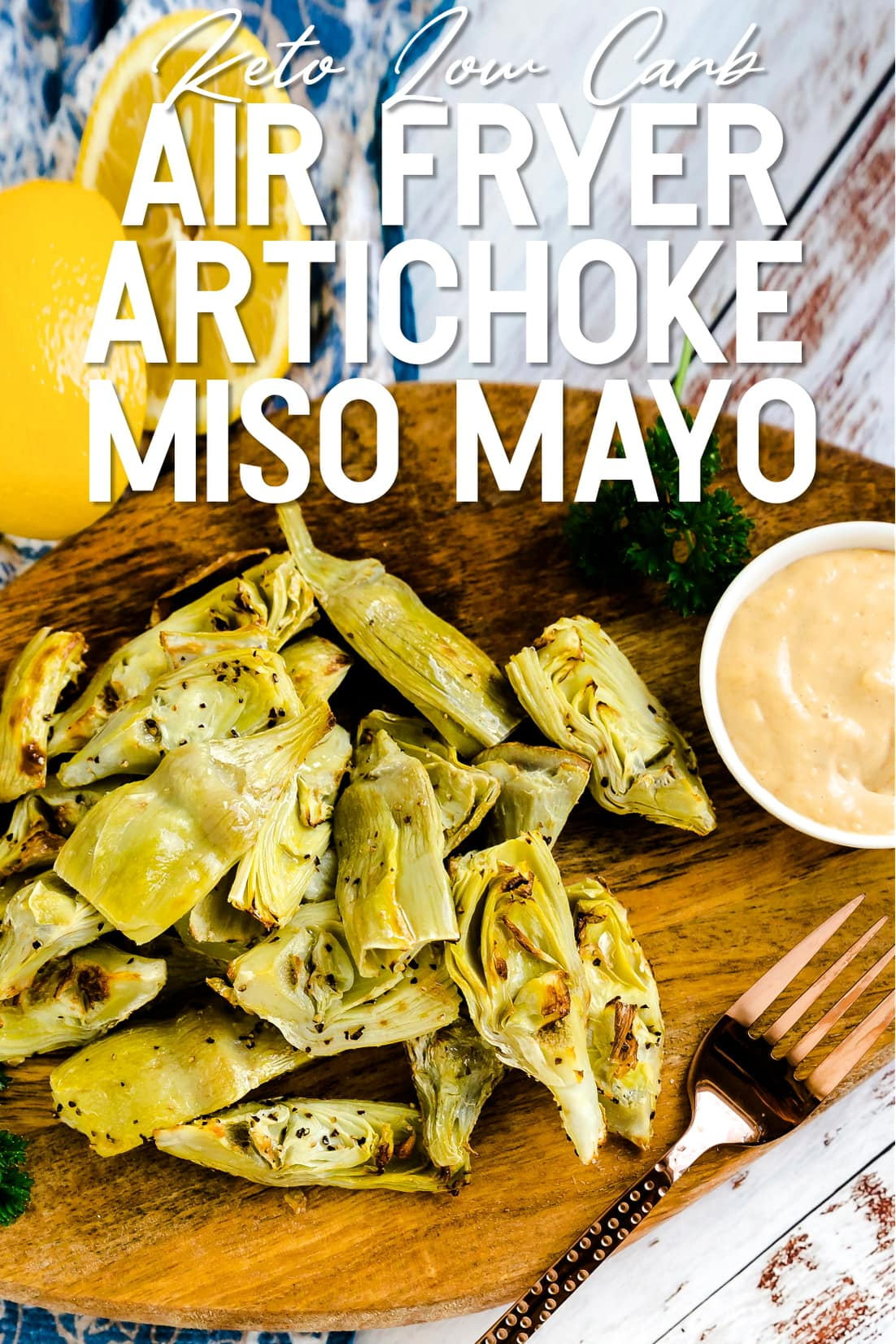 Air Fryer Artichoke served with garlic miso mayo sauce on a wooden plank