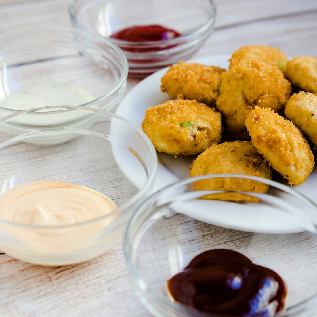 Air fried keto chicken nuggests with various keto dipping sauces