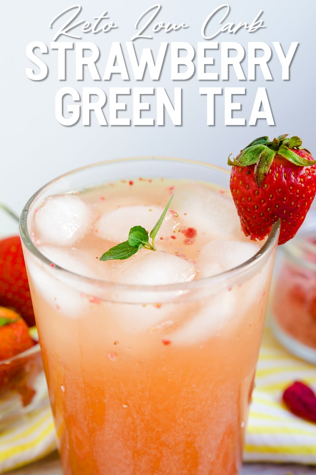 Keto Strawberry Iced Green Tea served in a glass tumbler with a strawberry