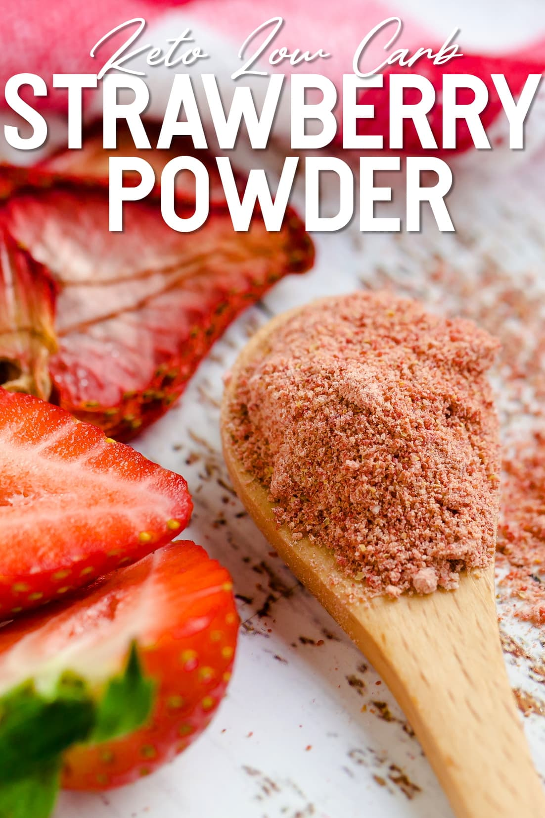 Keto Strawberry Powder in a wooden spoon