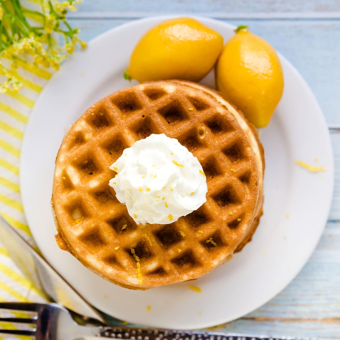 Lemon Cake Chaffles with whip cream served on a plate