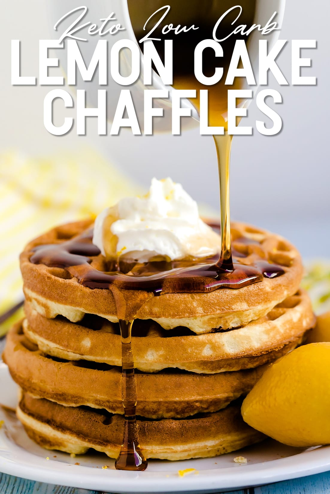 Lemon Cake Chaffles with whip cream and keto maple syrup being poured