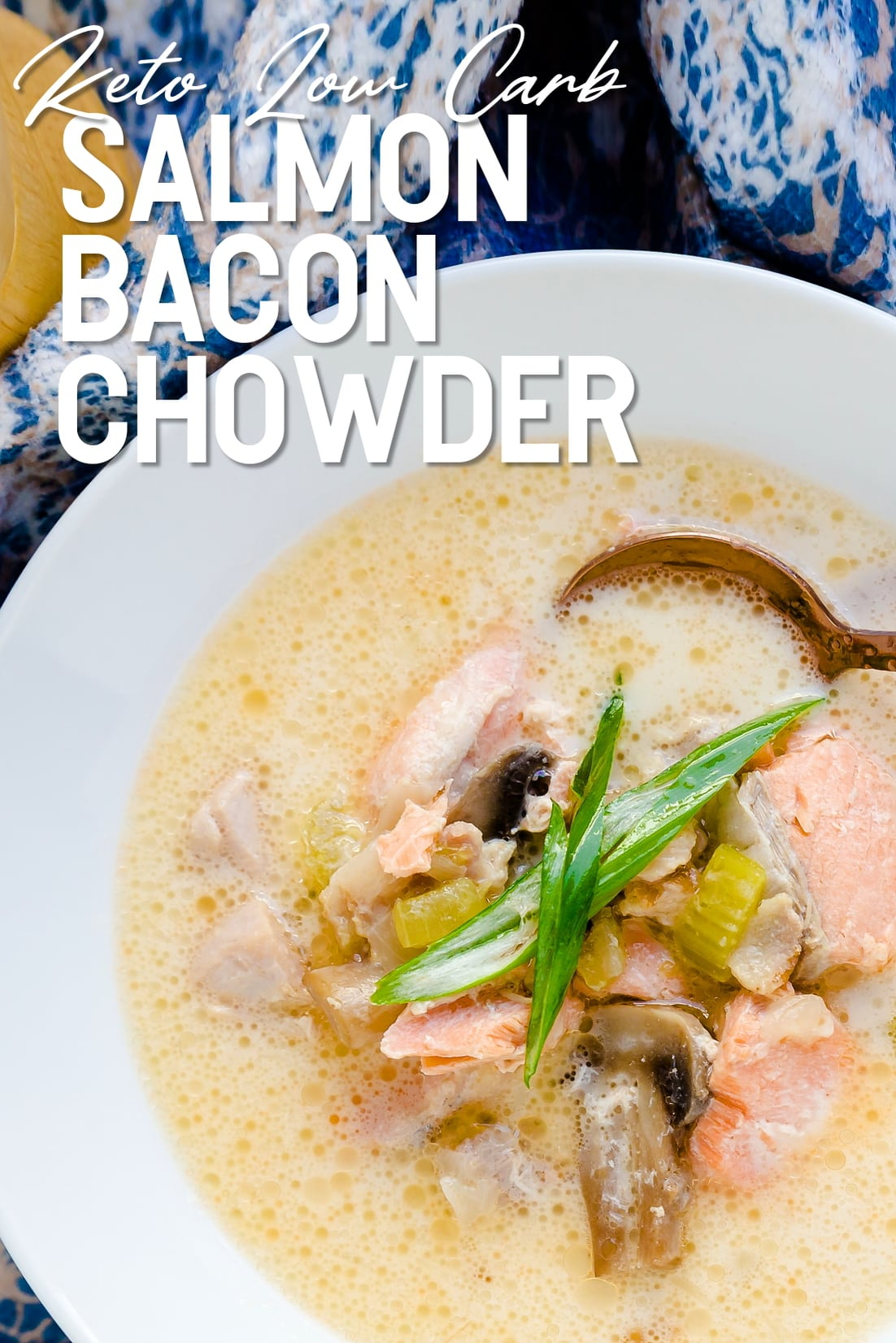 Salmon Bacon Chowder served in a white bowl with golden spoon top down