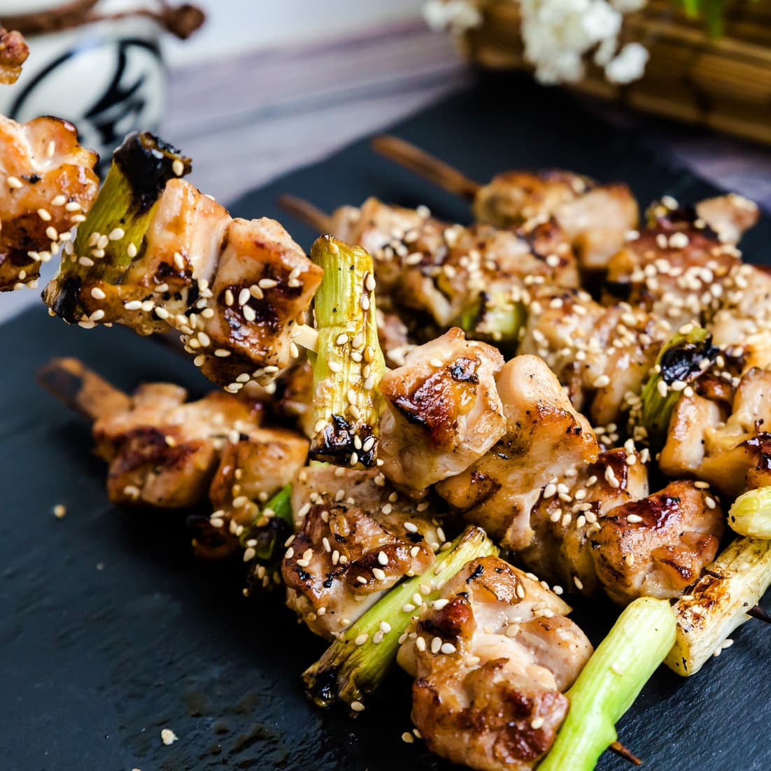 Yakitori grilled Japanese chicken with green onions on a skewer