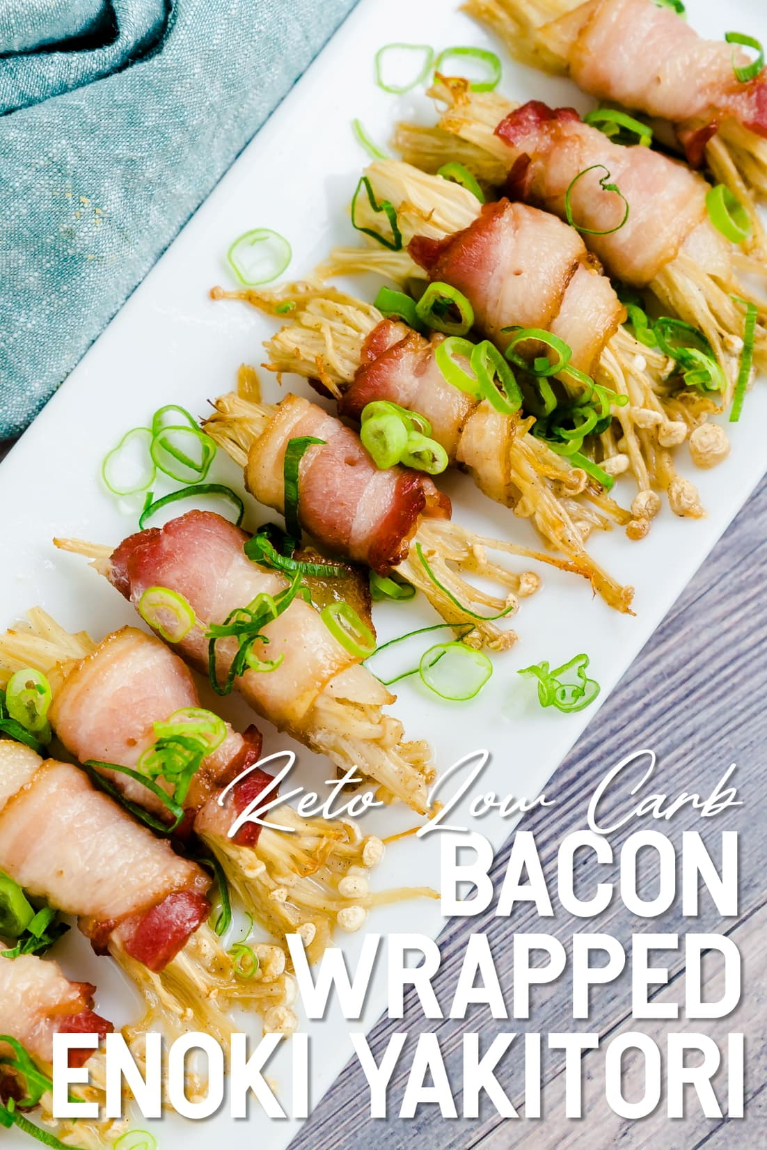 Bacon Wrapped Enoki Yakitori served on a white plate with green onions