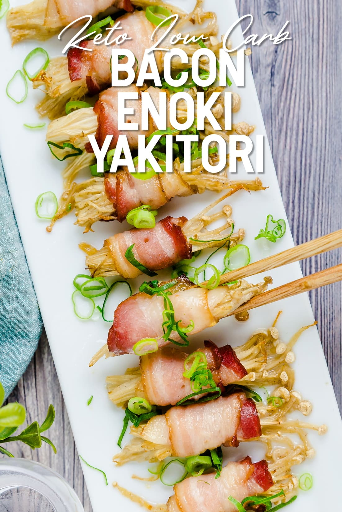 Bacon Wrapped Enoki Yakitori being picked up with chopsticks
