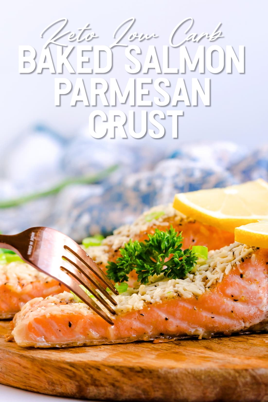 Baked Salmon with Parmesan Crust being cut into with a golden fork