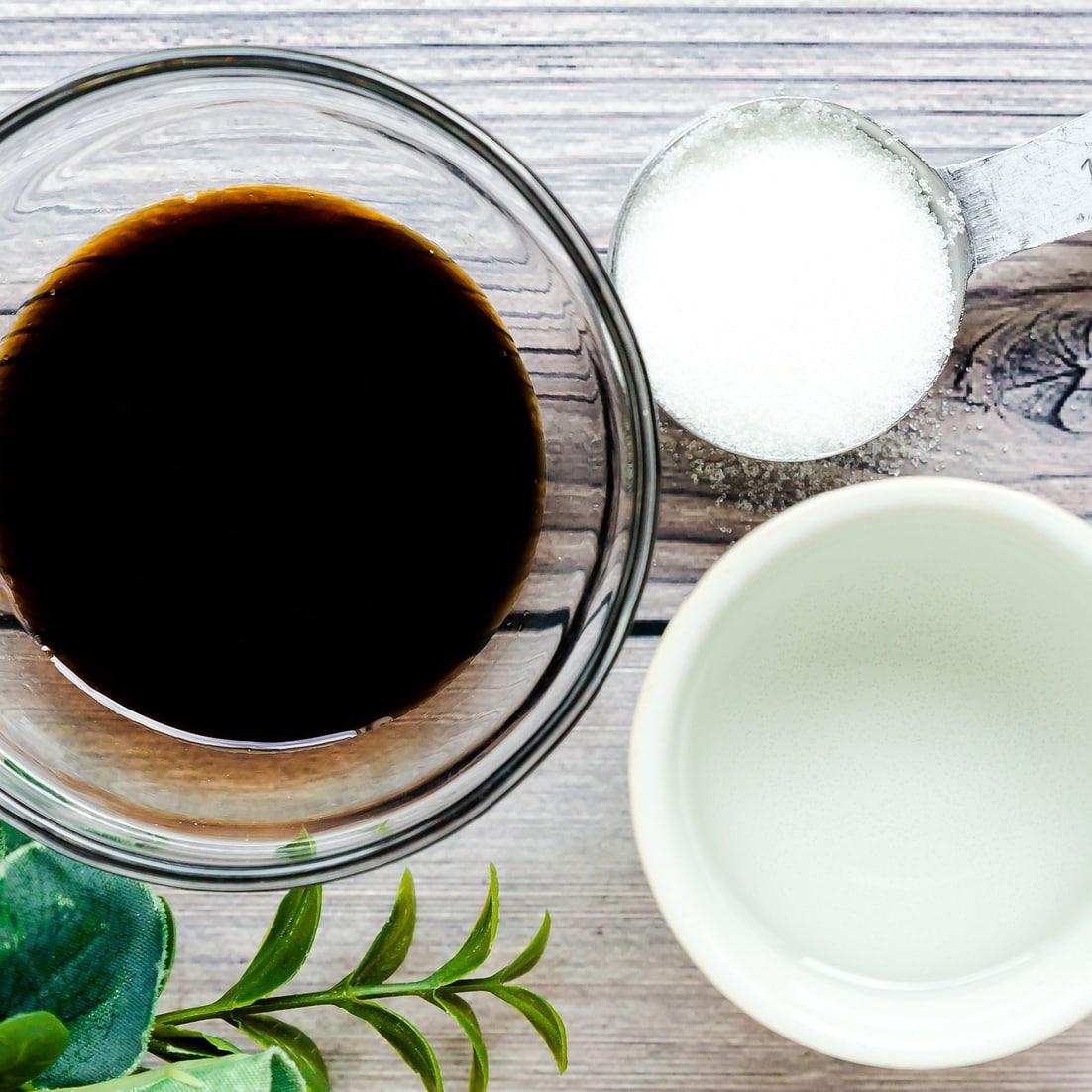 Ingredients for Japanese donburi sauce in measuring bowls