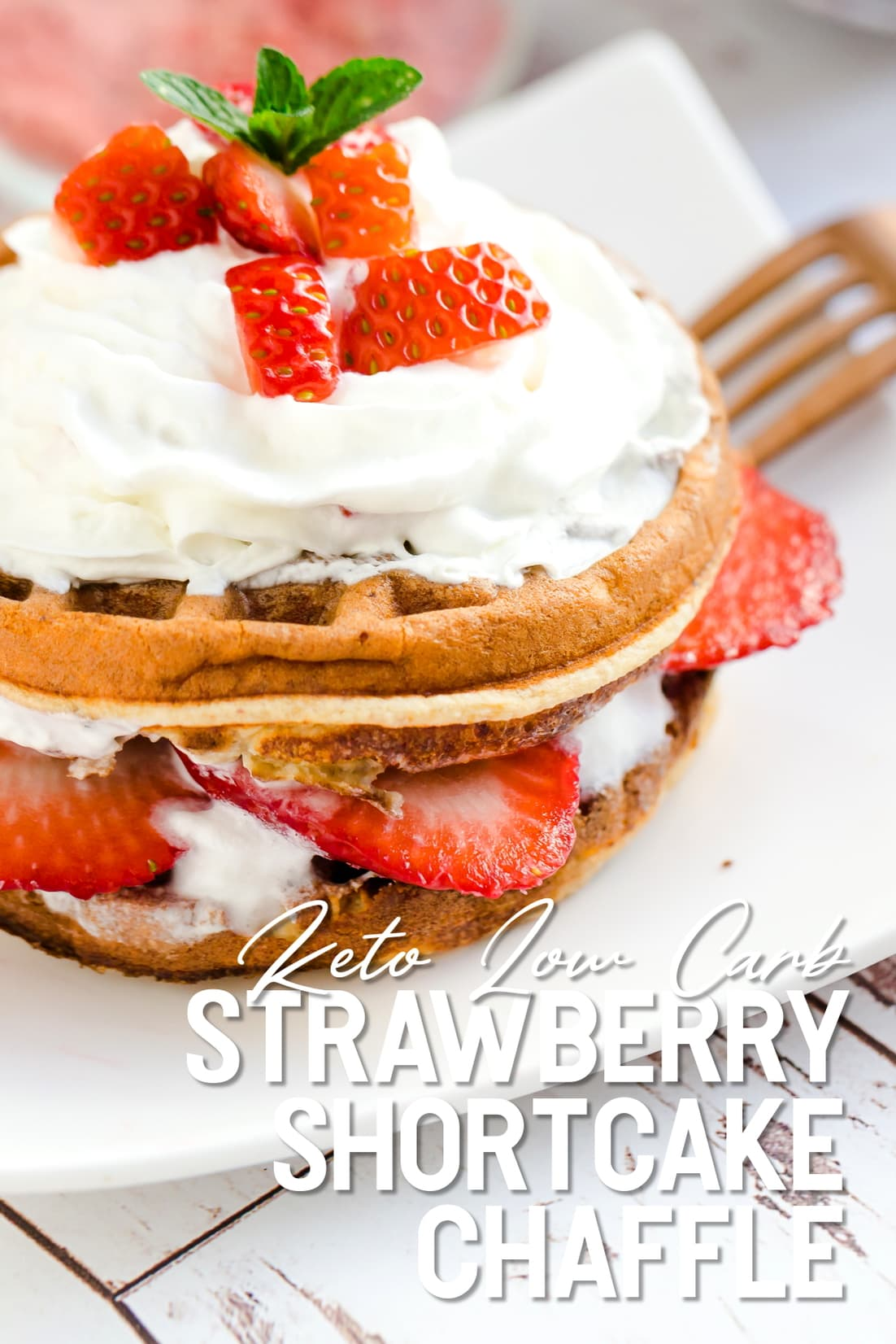 Keto Strawberry Shortcake Chaffle served with whip cream and sliced strawberries