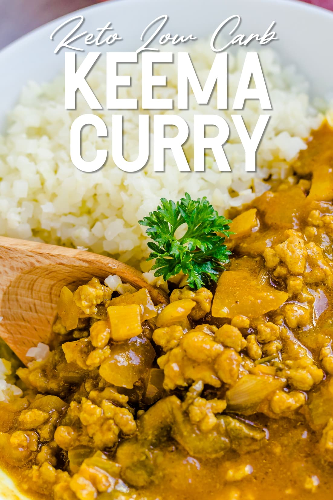Keto Keema Cauliflower Curry being scooped with a wooden spoon