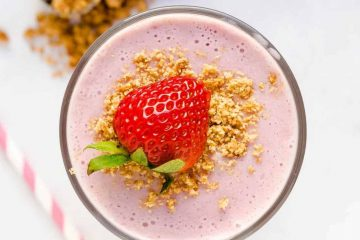 Keto Strawberry Cheesecake Smoothie served in a glass cup top down view