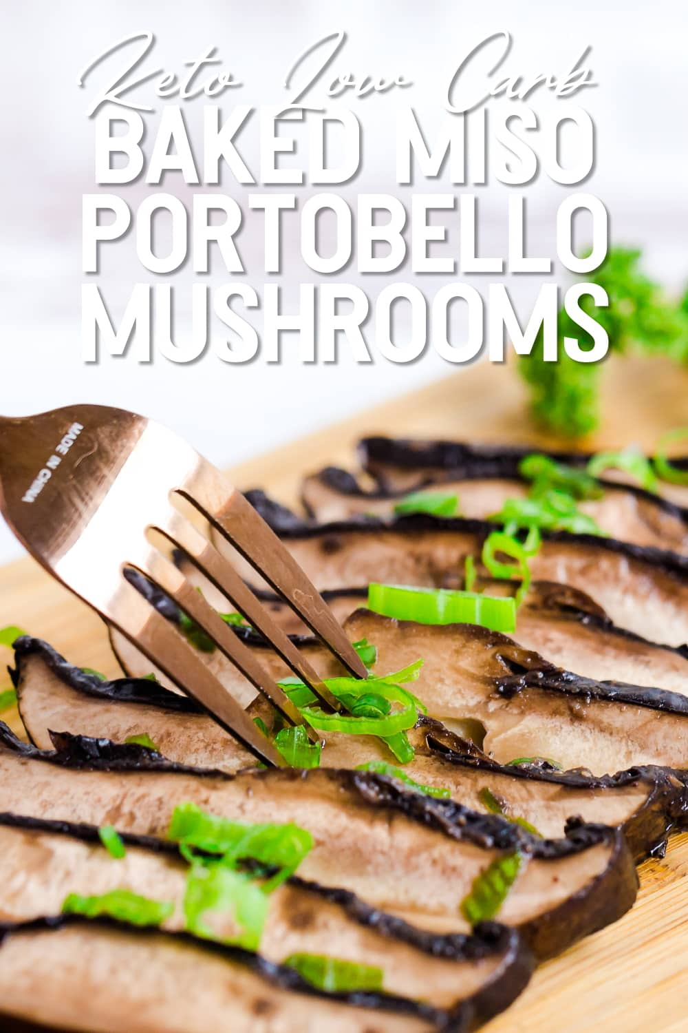 Baked Miso Portobello Mushrooms served with sprinkle green onions and fork